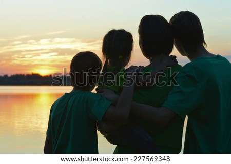 Portrait of a happy family resting in park - stock photo