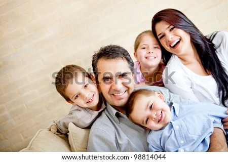 Portrait of a happy family smiling at home - stock photo