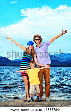 Portrait of a happy family with little son on vacation. - stock photo