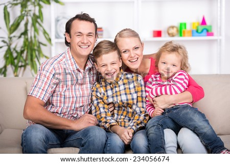 Portrait of a happy family. Young parents and their two children. - stock photo