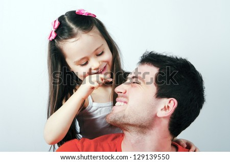 Portrait of a happy father and a beautiful little girl - stock photo