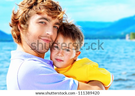 Portrait of a happy father with his little son on vacation. - stock photo