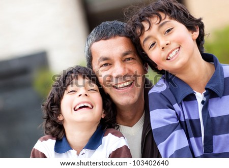 Portrait of a happy father with his two sons - stock photo