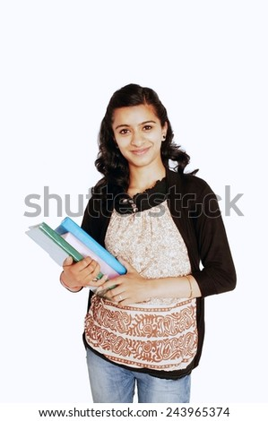 Portrait of a happy female Indian student over white. - stock photo