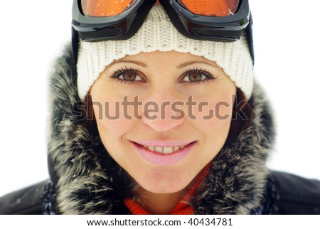 Portrait of a happy female skier isolated over white background