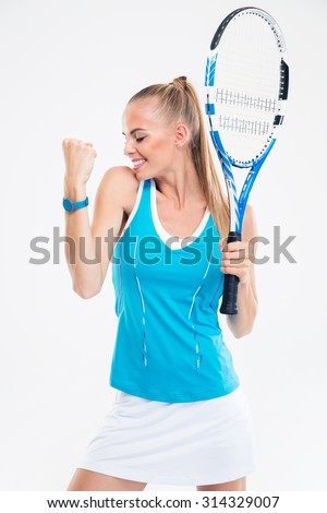 Portrait of a happy female tennis player celebrating her success isolated on a white background