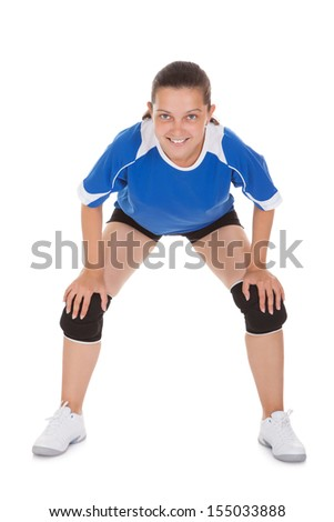 Portrait of a happy female Volleyball player over white background - stock photo