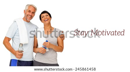 Portrait of a happy fit couple standing over white background - stock photo