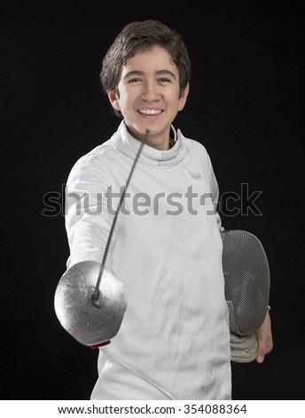 Portrait of a happy foil fencer on black background. - stock photo