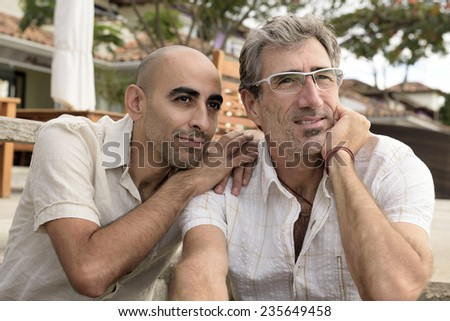 Portrait of a happy gay couple - stock photo