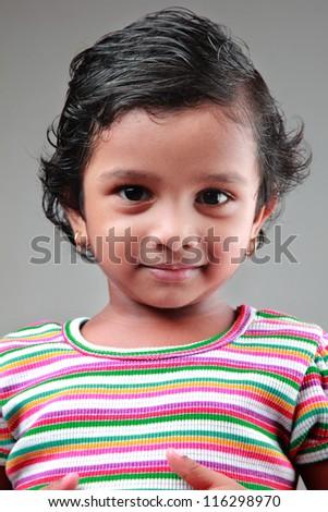 Portrait of a happy girl child - stock photo