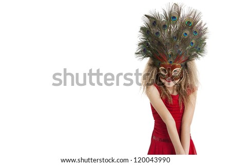 Portrait of a happy girl wearing peacock feather mask over white background