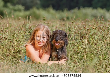 portrait of a happy girl with dog - stock photo