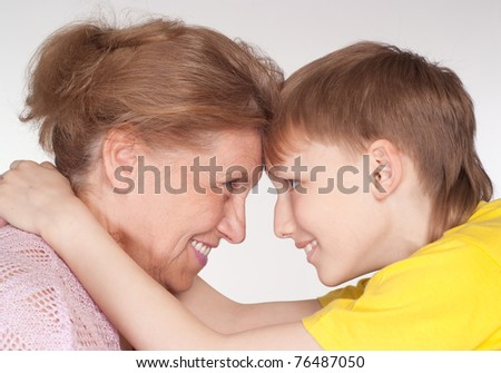 portrait of a happy grandmother and grandson