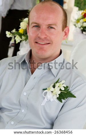 Portrait of a happy groom on his wedding day.