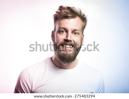 Portrait of a happy handsome full beard man on the white background. Color toned image. - stock photo