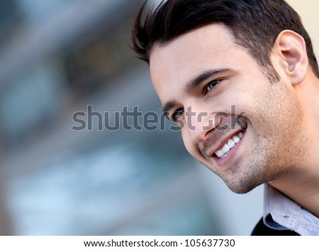 Portrait of a happy handsome man smiling - stock photo