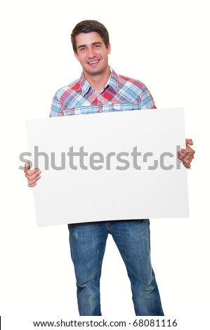 Portrait of a happy handsome young man holding blank white card over white background - stock photo