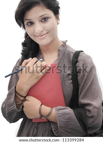 Portrait of a happy Indian / Asian college student on isolated white background - stock photo