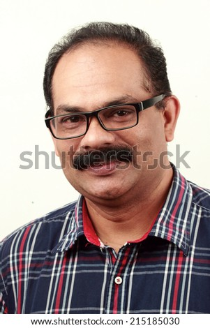 Portrait of a happy Indian man - stock photo