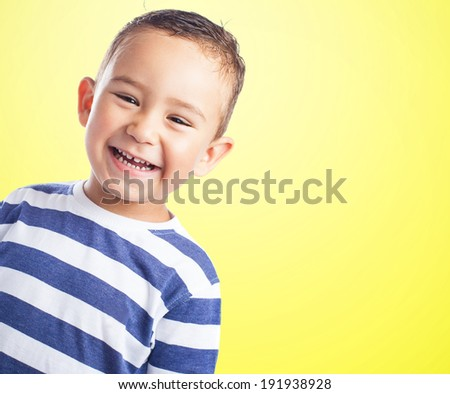 portrait of a happy kid smiling and having fun - stock photo