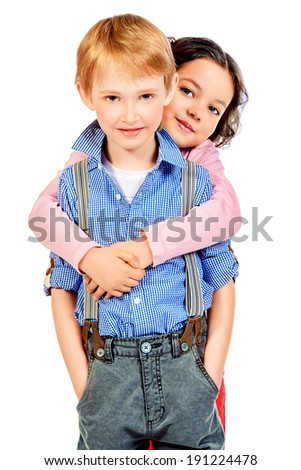 Portrait of a happy little girl embracing a cute boy. Children. Isolated over white. - stock photo