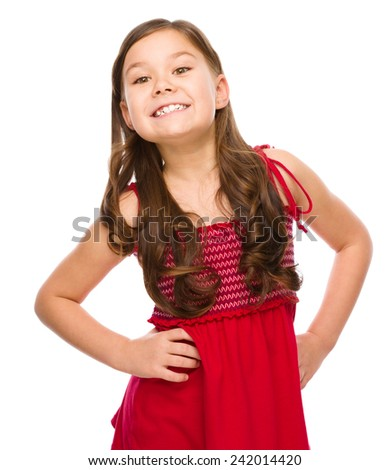 Portrait of a happy little girl in red dress, isolated over white - stock photo