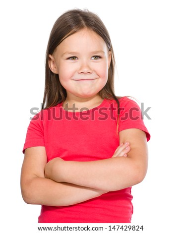 Portrait of a happy little girl in red t-shirt crossing her hands, isolated over white