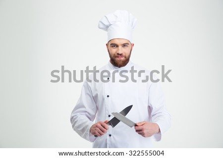 Portrait of a happy male chef cook sharpening knife isolated on a white background - stock photo