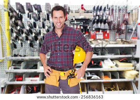 Portrait Of A Happy Male Technician With Tools