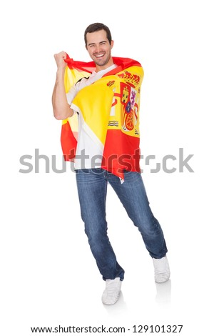 Portrait Of A Happy Man Holding An Spanish Flag. Isolated on white