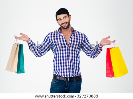 Portrait of a happy man holding shopping bags isolated on a white background - stock photo