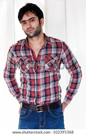 portrait of a happy man wearing checkered shirt - stock photo