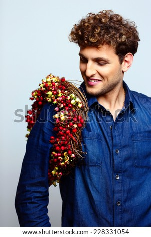 Portrait of a happy man with wreath on shoulder