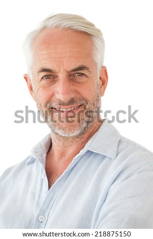 Portrait of a happy mature man over white background - stock photo