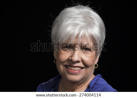 Portrait of a happy mature woman - stock photo