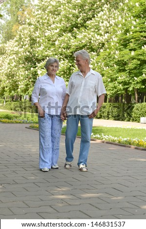 portrait of a happy middle-aged couple on a walk in the park in spring