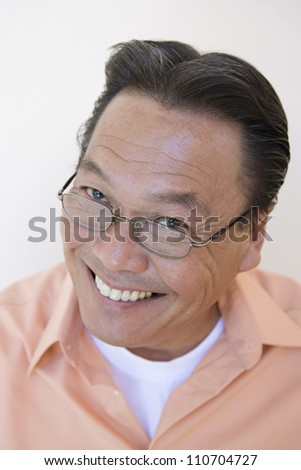 Portrait of a happy middle aged man with glasses