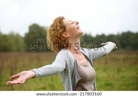 Portrait of a happy middle aged woman enjoying life - stock photo