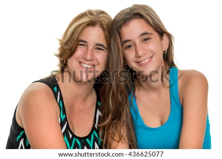 Portrait of a happy mother and her teenage daughter - Isolated on white