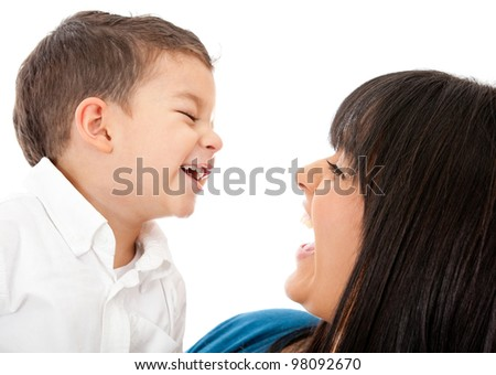 Portrait of a happy mother and son laughing - isolated over a white background - stock photo