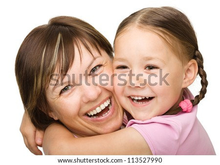Portrait of a happy mother hugging her daughter, isolated over white