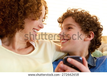 Portrait of a happy mother looking at her smiling son - stock photo