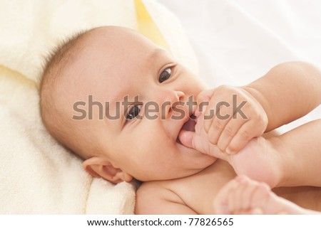 portrait of a happy newborn on a bed