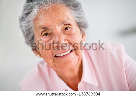 Portrait of a happy old woman smiling - stock photo