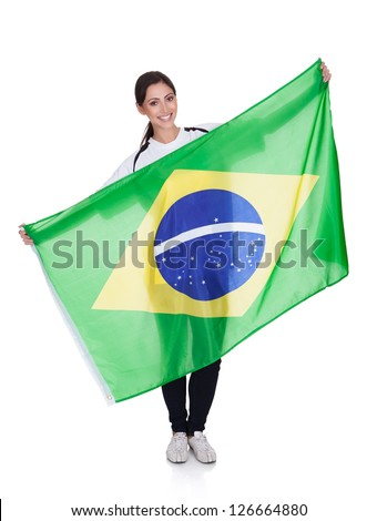 Portrait Of A Happy Pretty Woman Holding Brazilian Flag. Isolated On White - stock photo