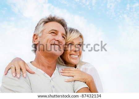Portrait of a happy romantic couple outdoors. - stock photo
