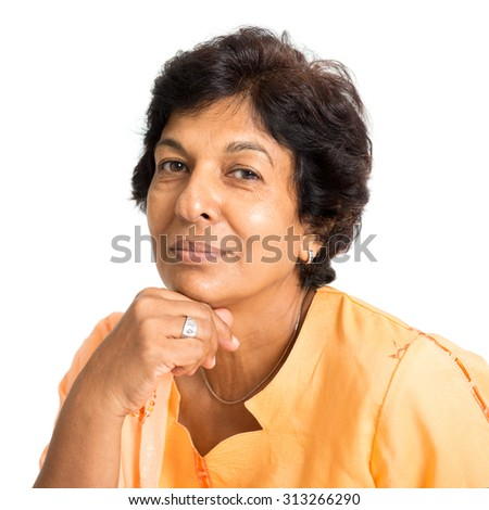 Portrait of a happy 50s Indian mature woman smiling and looking at camera, isolated on white background. - stock photo
