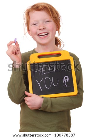 Portrait of a happy schoolgirl holding a blackboard