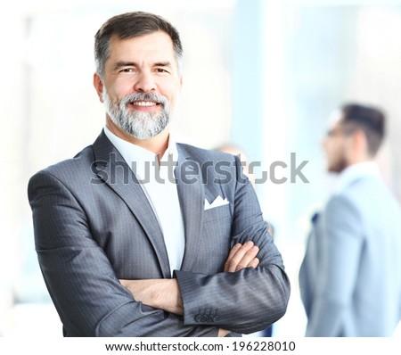 Portrait of a happy senior business man smiling  - stock photo